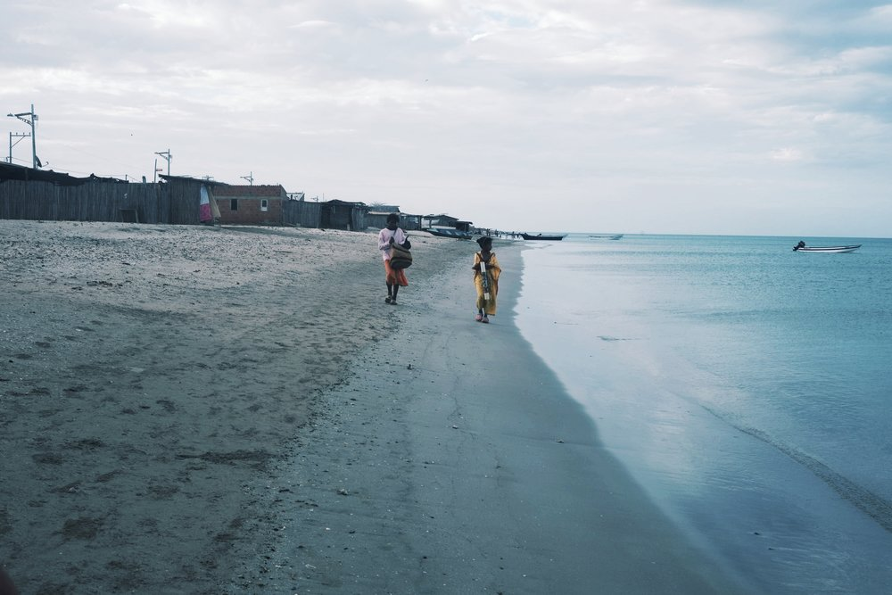 Girls walking along the beach.