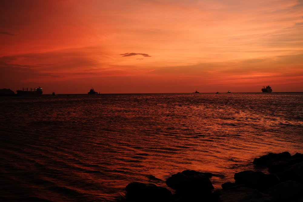Santa Marta at sunset - Enjoy the city's priceless sunsets: the sky turns a psychedelic pink/red/orange once the sun goes down.