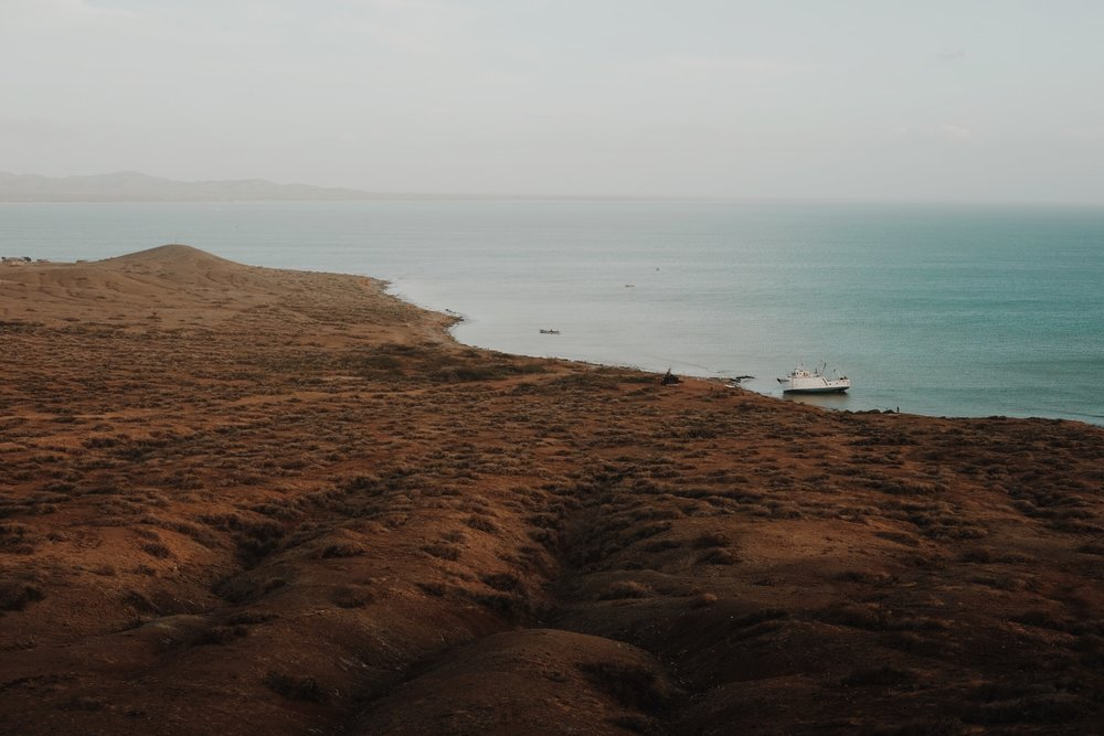 Cabo de la Vela - Arrange a tour to Cabo de la Velas (the northernmost tip of South America, just a stone throw away from Venezuela). This place is magical! We recommend staying 2 nights here to chill out and kite surf. Head to Punta Gallinas to witness an incredible sunset.