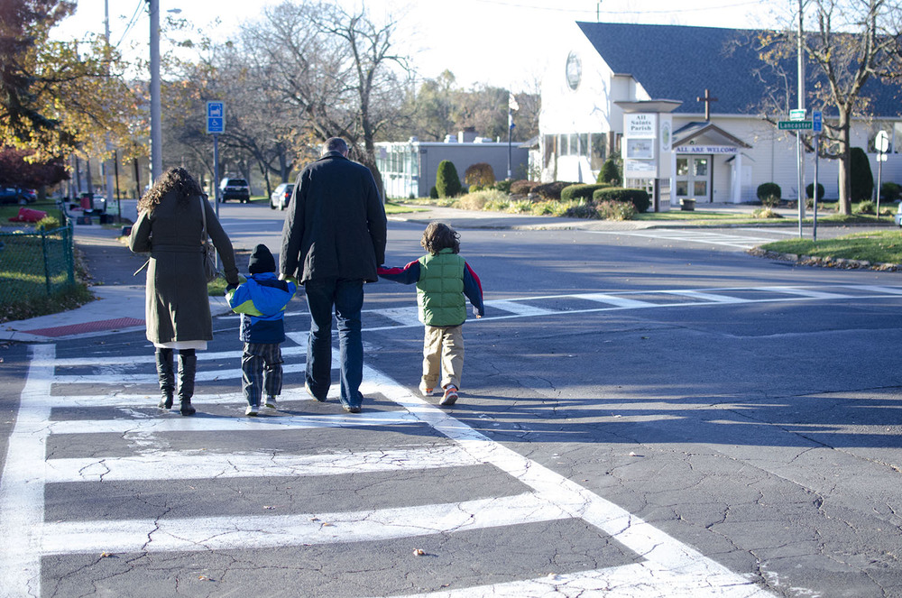 Around 8 a.m. on Election Day before school starts, Bott walks with his family to the polling station down the street from their home.
