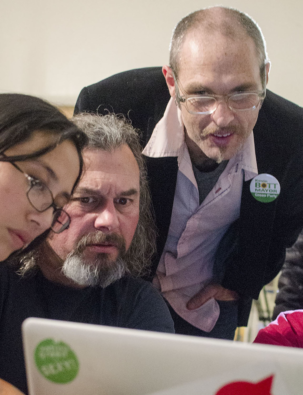 At the end of Election Day 2013, Bott reviews the voting results alongside Green Party supporters Maria Ordonez, 24, and Dave Kashmer, 56.