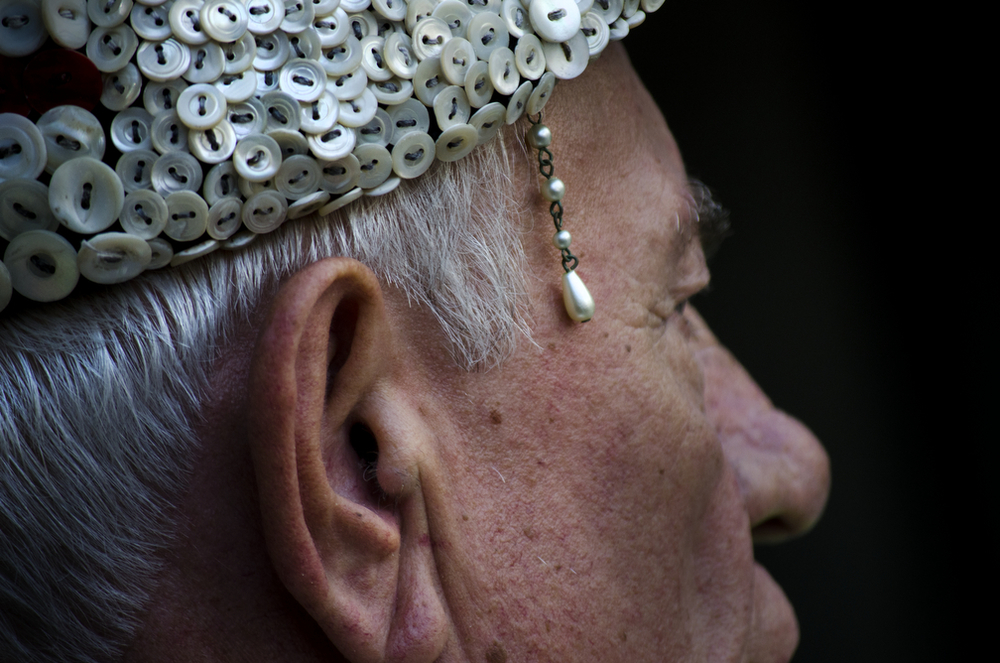 This pearly king bears a short string of pearls on his pearly cap at the Pearly Kings and Queens annual parade at Guildhall.