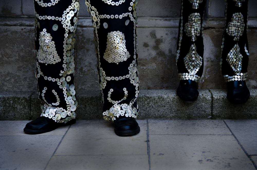 Two pearlies line up against the wall to pose for a group photo at the Parade at Guildhall on Sunday, September 28, 2014.