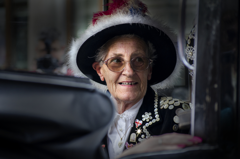 This Pearly Queen rides in an old-fashioned car as part of the annual parade at Guildhall on September 28, 2014.