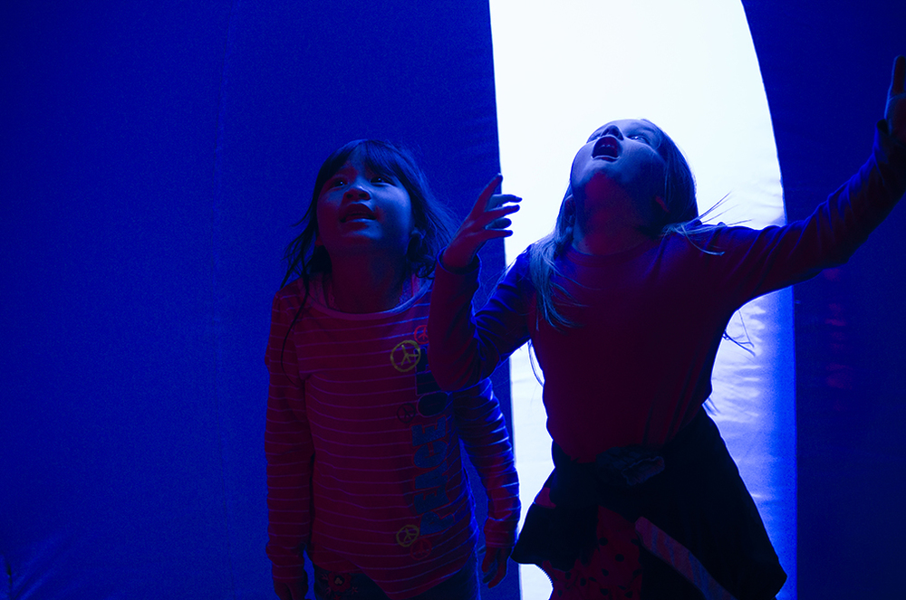 At the Pittsburgh Cultural Trust's Children's Festival, two young girls admire the wonders of the Luminarium, essentially an over-sized balloon made for people to explore.