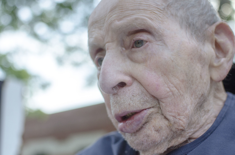 As he recovers from a sorely broken arm, Sam Goodman, 101, sits outside admiring the warm summer breeze outside the Hebrew Home in West Hartford, CT.