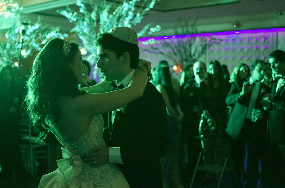 Steven Pahuskin and his new bride, Jaclyn share in their first dance as husband and wife.