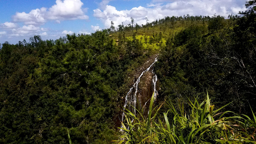 Tiger Creek Falls, as seen from one of many private lookouts, crash down the Mountain Pine Ridge of Belize.