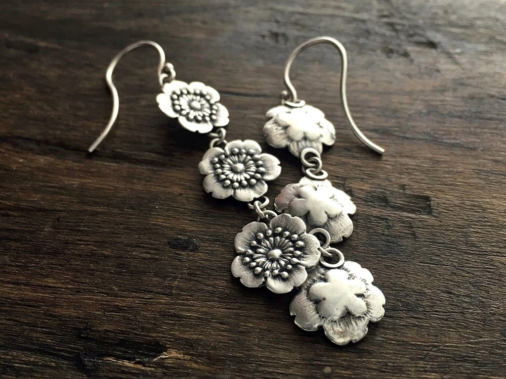 Three Little Flowers Earrings on Wood.jpeg