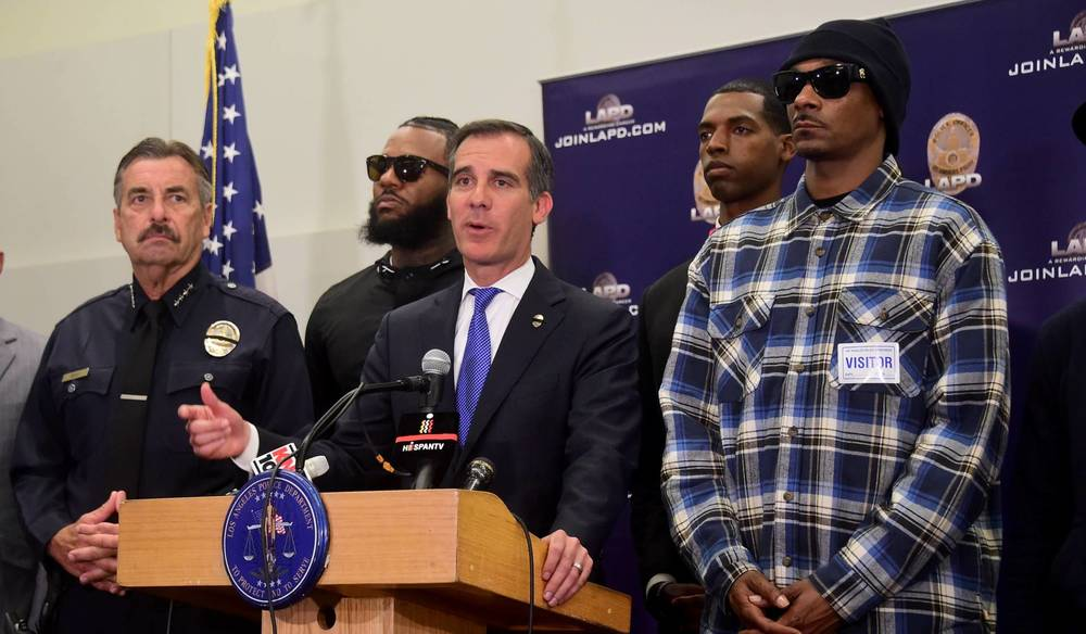 LA Mayor Eric Garcetti, LAPD Chief Charlie Beck and gangsta rappers The Game and Snoop Dogg address the media.