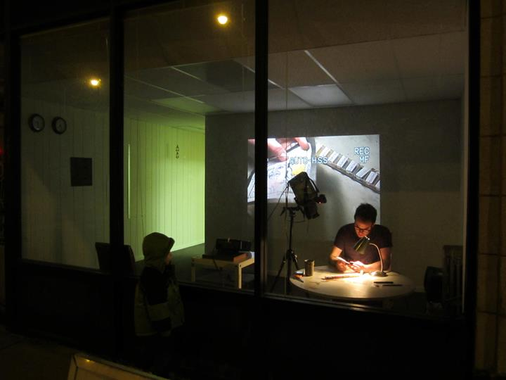 Resident artist Riley Henderson in the project space, 2012