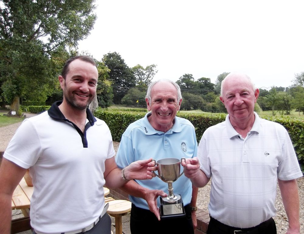 Cliff Lewin and Terry McCusker being presented with the Ron Fitch Memorial trophy by Jeff Moore