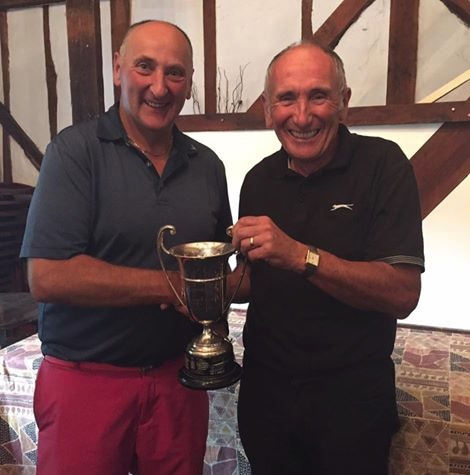 Paul Fowler receiving the club championship trophy from Jeff Moore