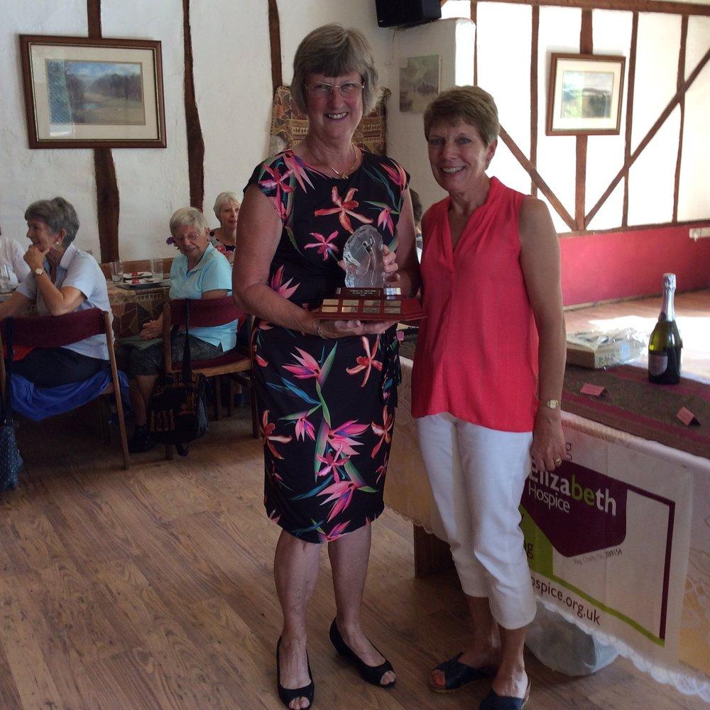 Members winner Margaret Upton with the Joan Clarke Trophy.