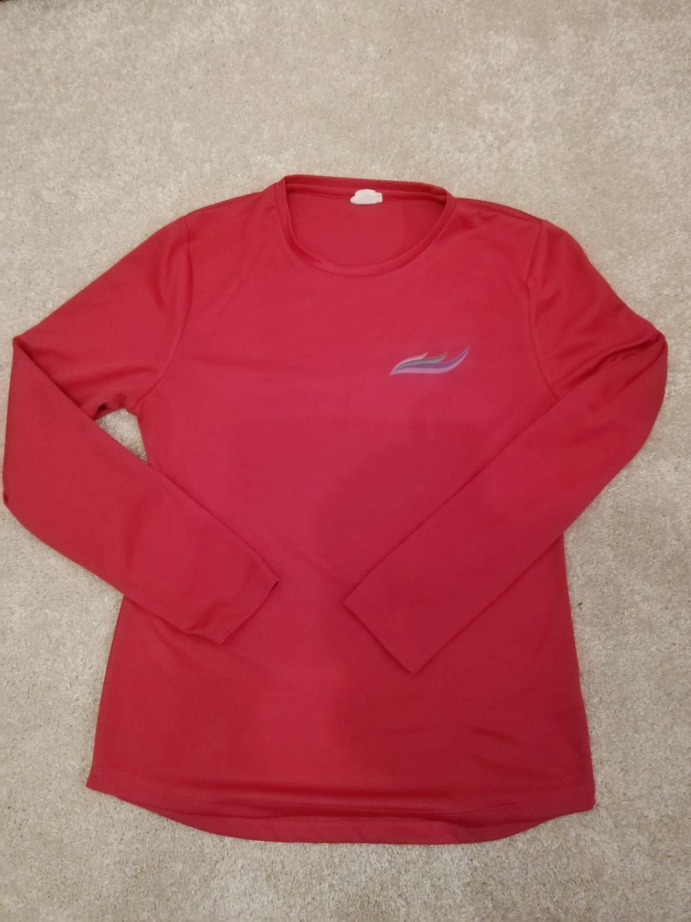 LONg sleeve t-shirt   Now the weather is getting colder, you may prefer to run in a long sleeve top. We suggest layers is the way forward for coping with the cold. Sizes small to X-Large   COST: £18