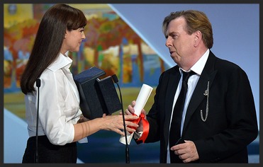 Actor Timothy Spall receiving his best actor award for Mr Turner