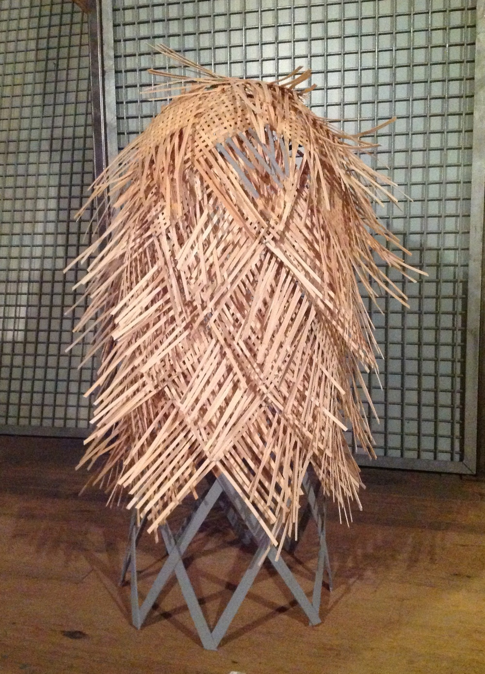 "1/2 scale model of ""basket"" inspired by the Fibonacci Sequence found in a pine cone. 3 + feet tall. Full scale version will be approximately 6 feet tall!"