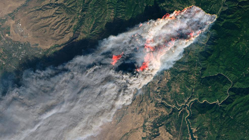 Enhanced satellite image of 2018 Camp Fire in California provided by NASA's Earth Observatory.