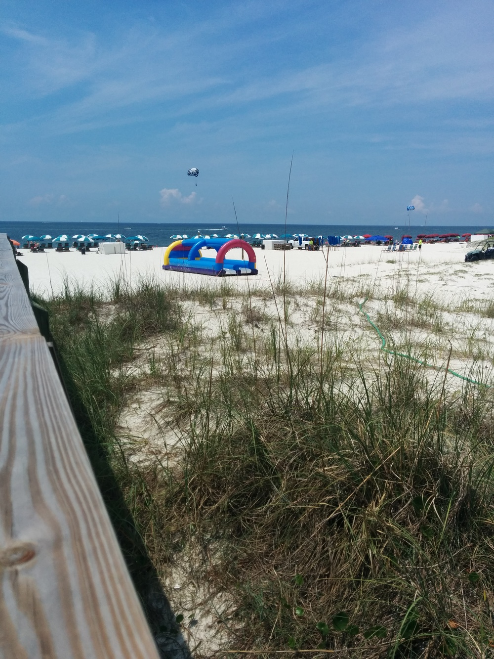 Slip and Slide inflatable water slide setup in Orange Beach Al