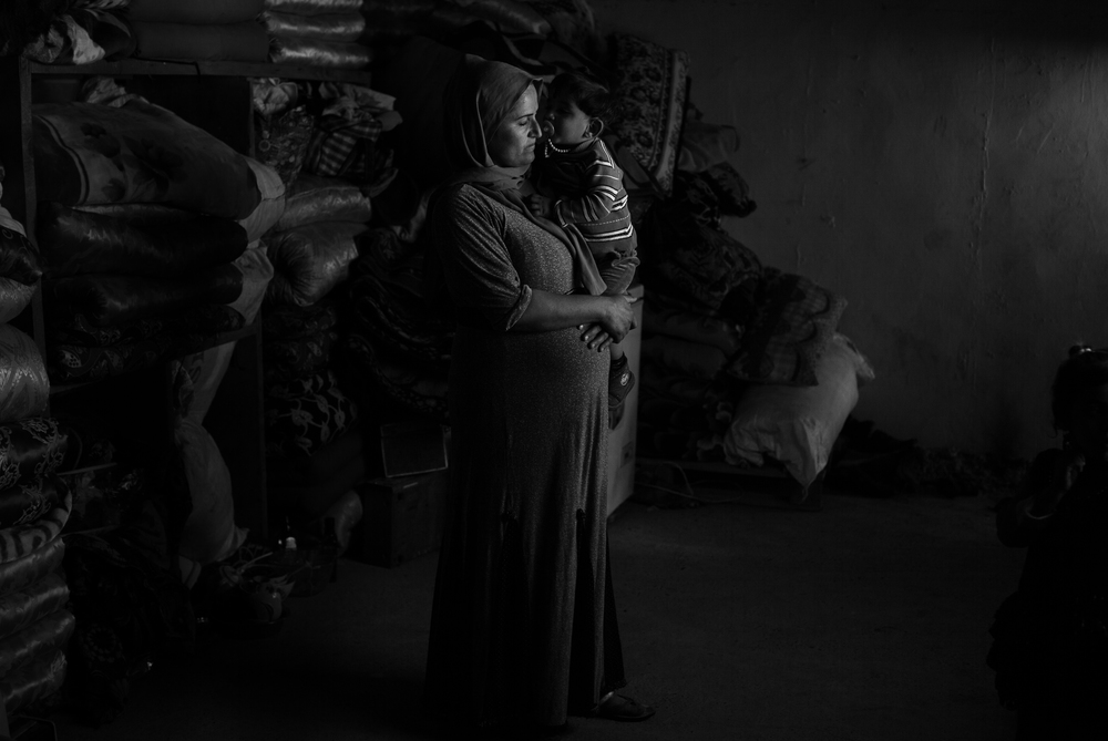 Layla and her daughter at home in Sinjar. She, her husband and their four children escaped the Islamic State, taking refuge in the mountains near by.  Sinjar, Iraq   March 2016