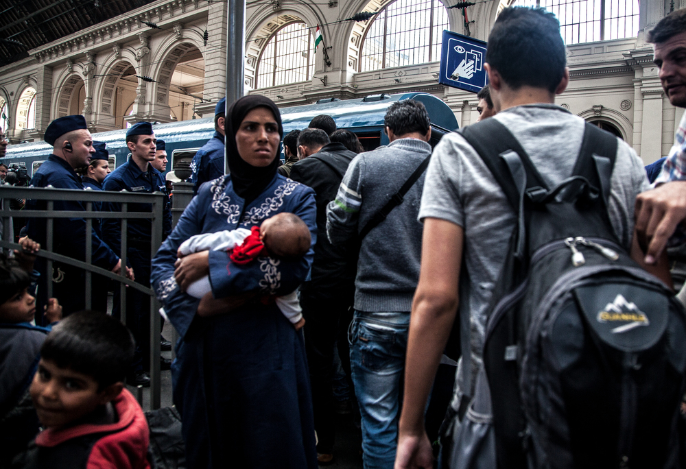 A mother and child bording a train at Budapest Central Station bound for Vienna in Austria.
