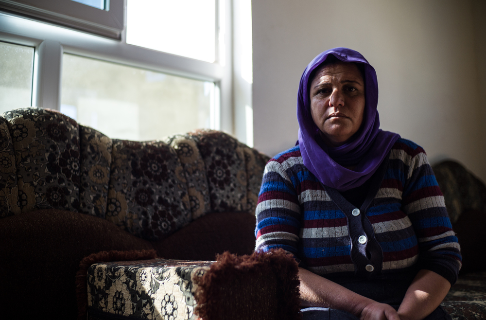 Hiam Sardo Hassan sits in her house in the village of Borek, in Northern Iraq.