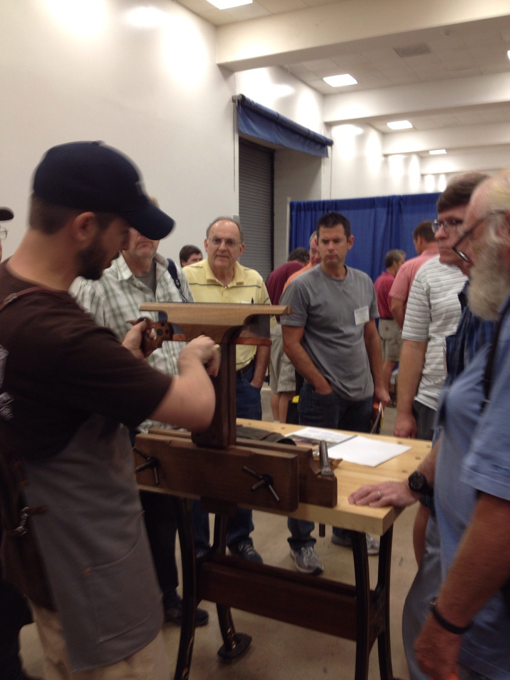 Drawing a crowd as I demonstrate our Saw Vise prototype.