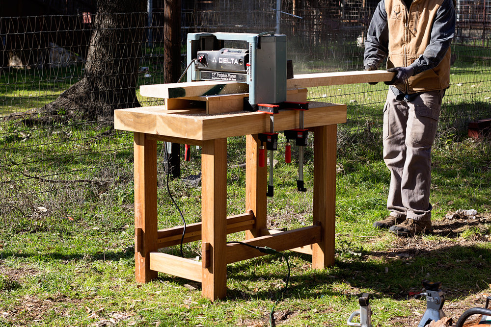 Taking advantage of a nice January afternoon to thickness all of the lumber with my portable planer.