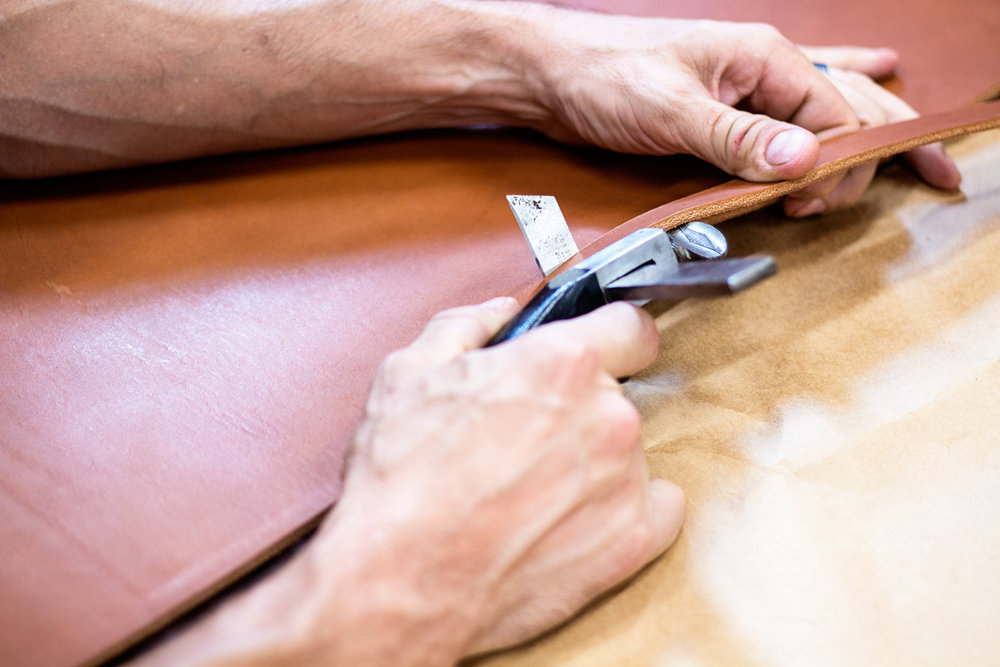 Each strip of leather is cut by hand, one at a time. No machines here!