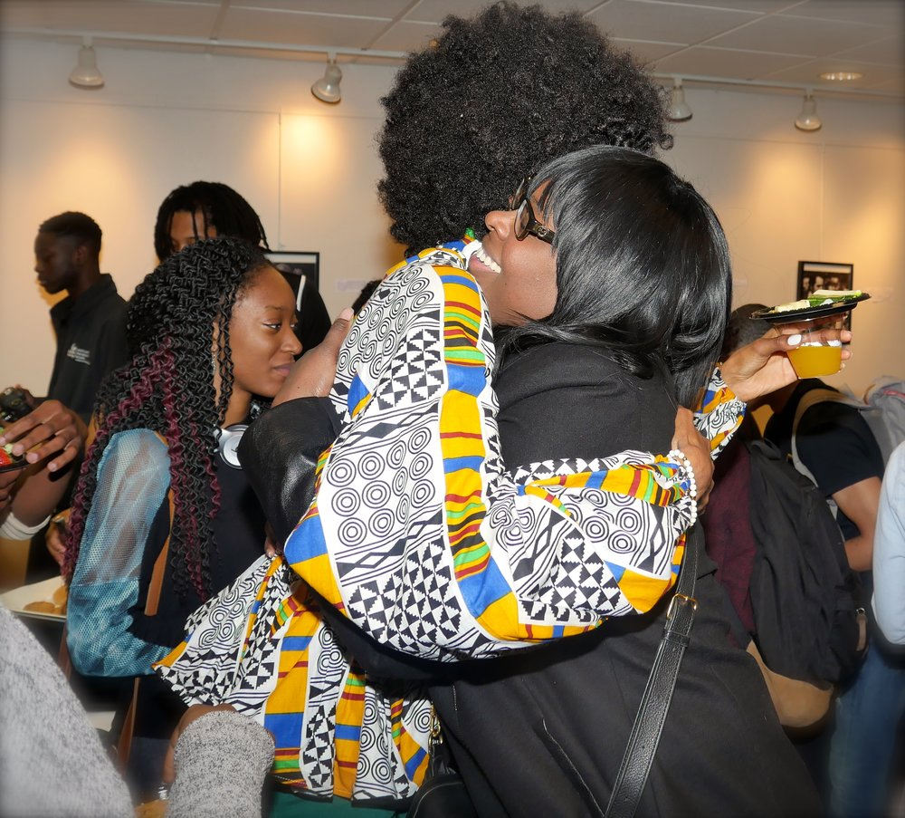Tierra Benton and Mentor Eshe Collins embrace during the Distinguished Alumna Series Reception