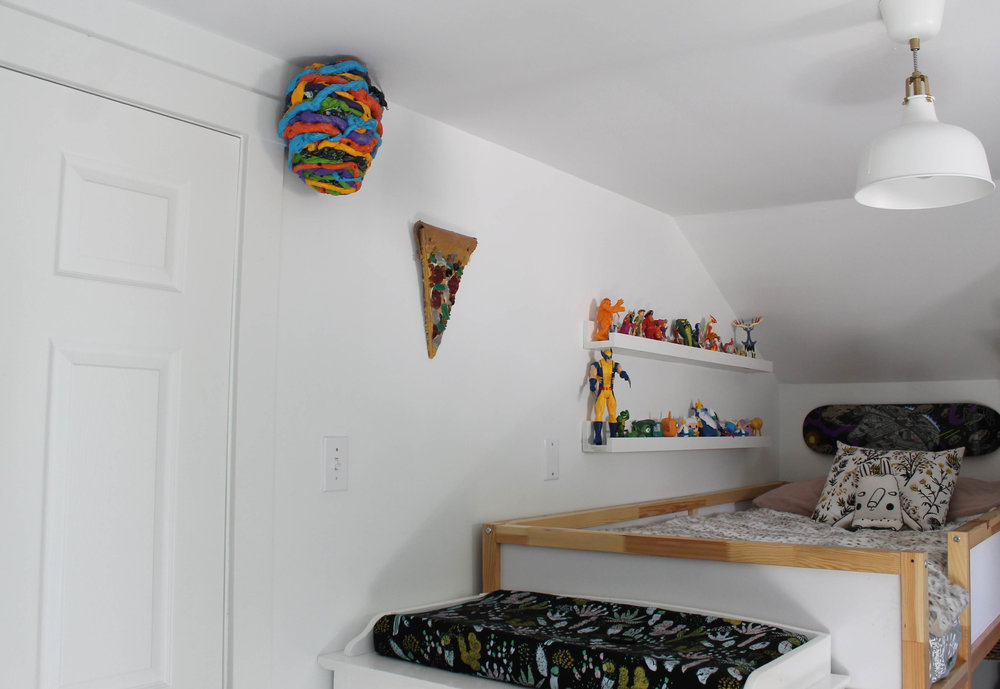 Wolfgang's little corner of the world. :) Beehive and Pizza sculptures by his Dad, Johnston Foster.