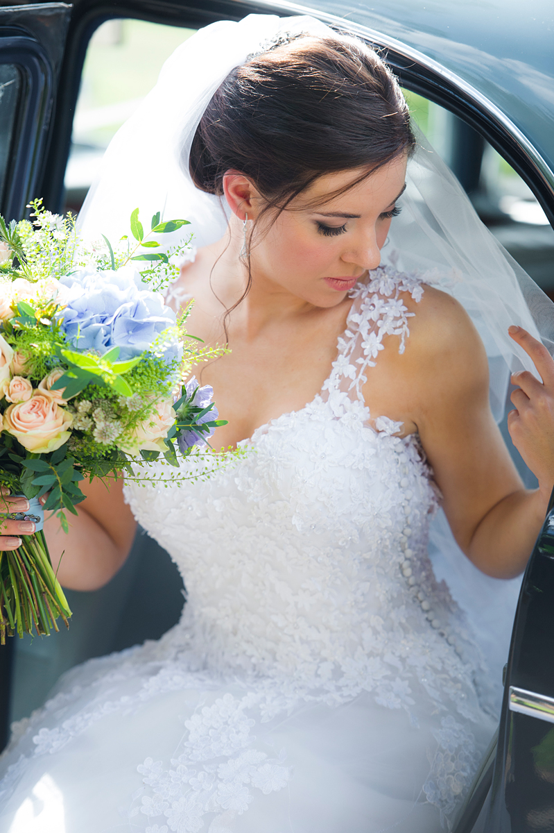 a photograph of a stunning bride as she leaves her car before her wedding