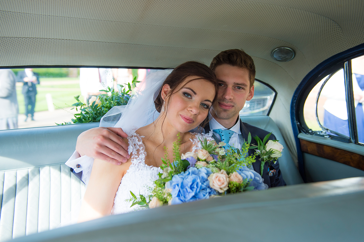 bride and groom in car after ceremony