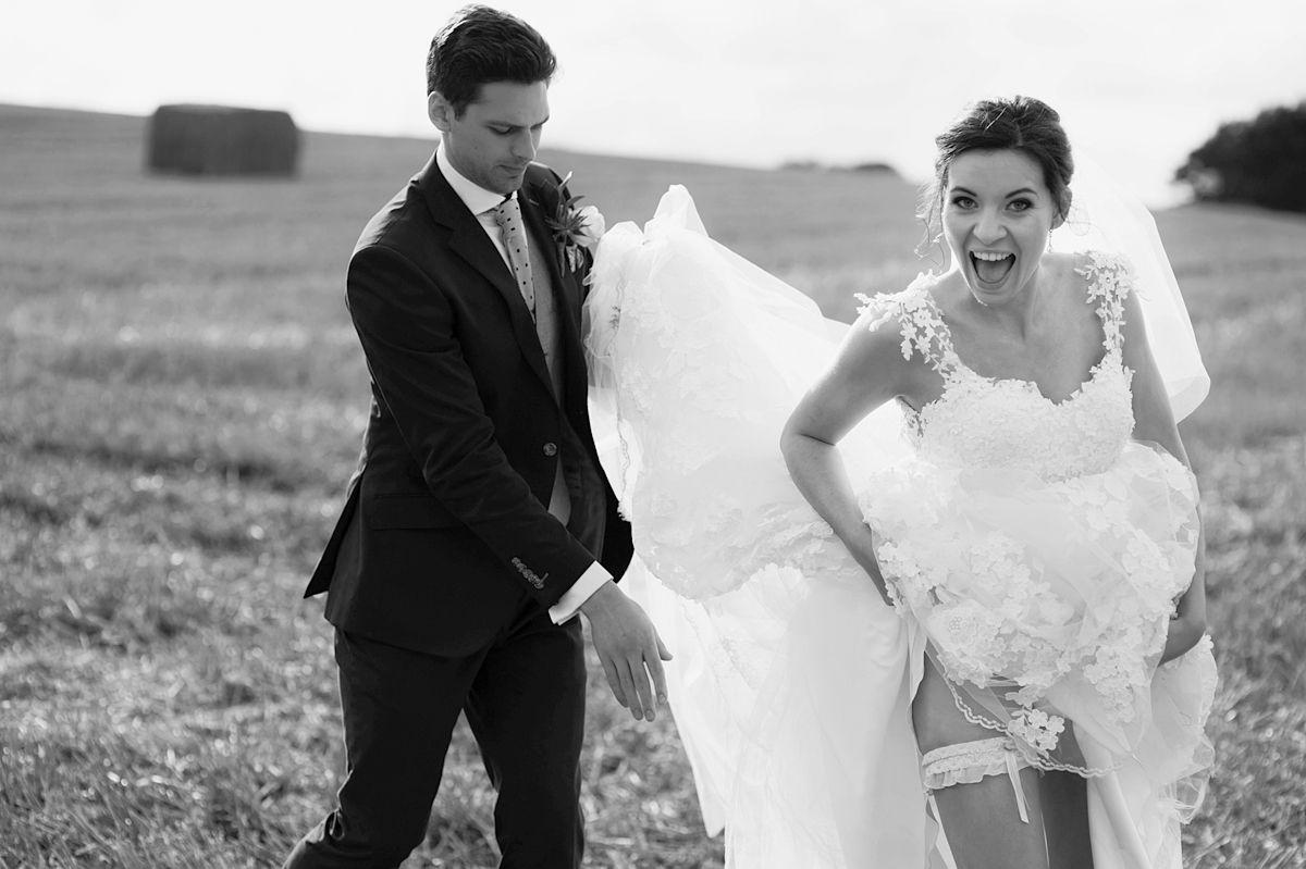bride reveals garter and bursts into laughter