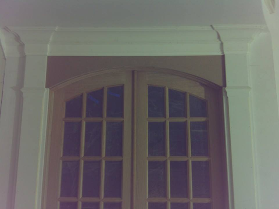 Dan Flanagan Arched Cherry Doors w. header.jpg