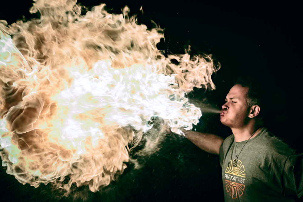 Adrian Feliciano breathing fire at an event in Hartford, Maine.  Photo by Artemis .
