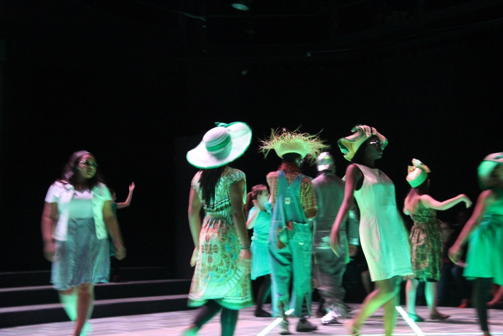 Dorothy and friends walking through the Emerald City