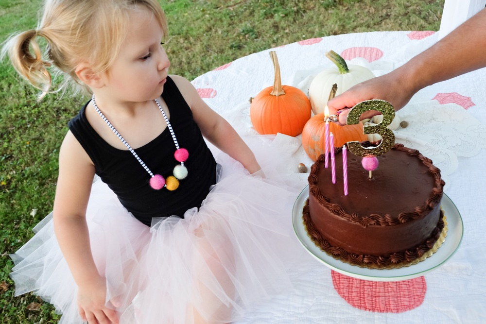 She was so excited to eat the cake that she started poking dots in it before we could even get the candles in! I let her stick them in the cake. Look at that sweet face patiently waiting.