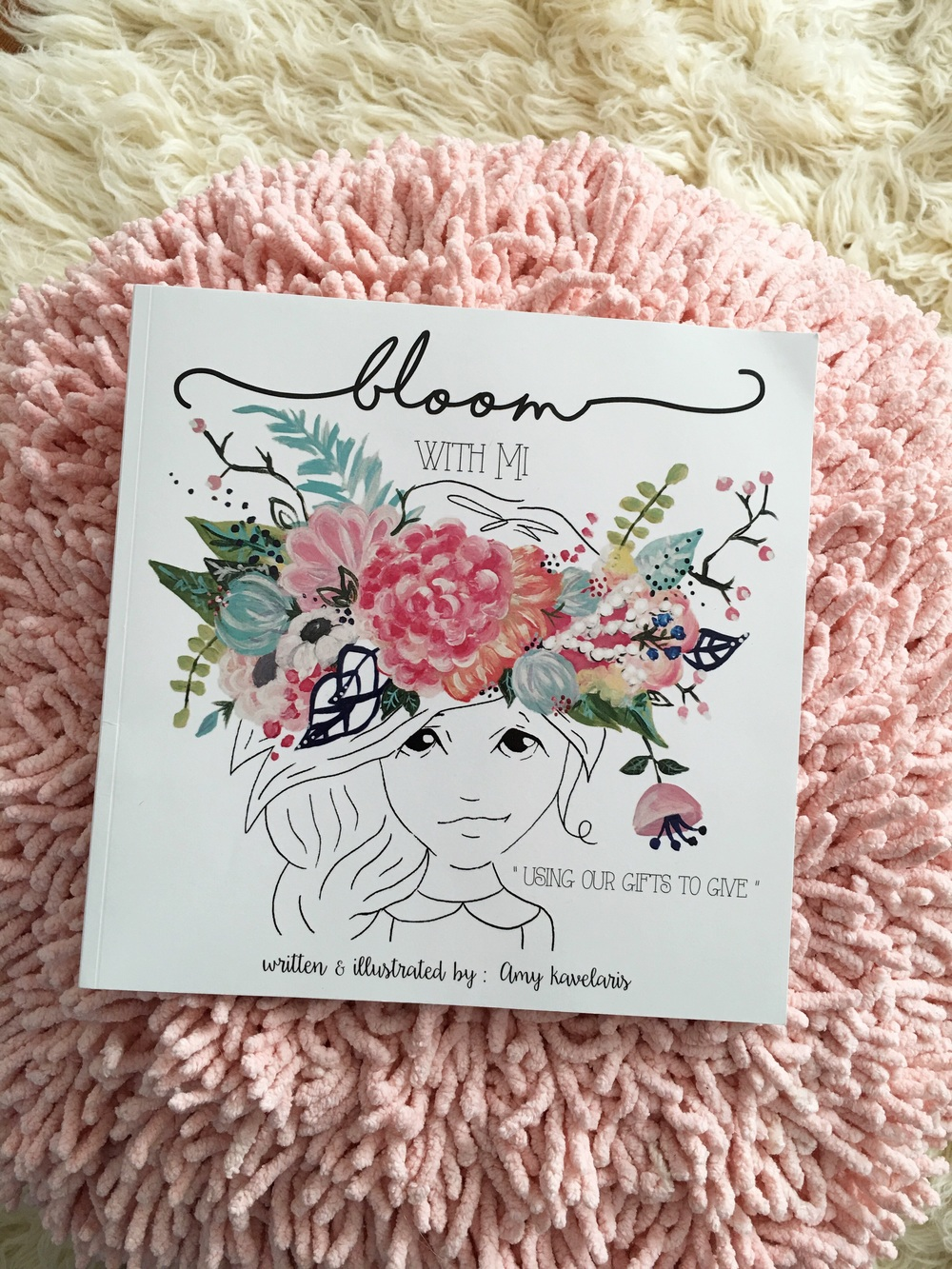 "We are excited about our friend, Amy Kavelaris's new book! It's called Bloom with MI, ""Using Our Gifts To Give!"" It's a beautiful book that captures the essence of childhood and giving."