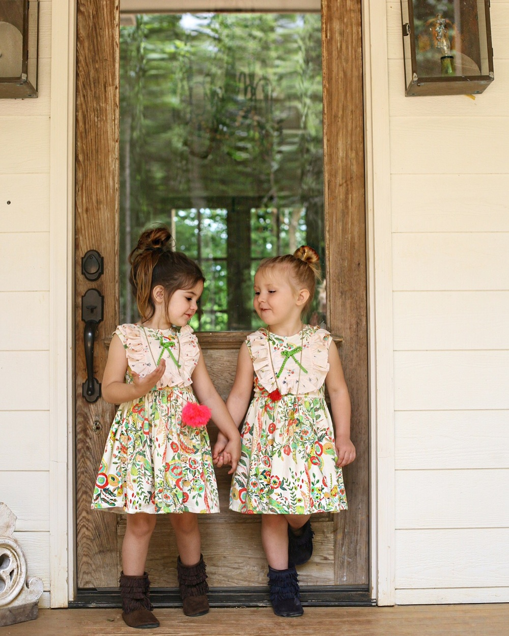 The girls became instant best friends. It melted my heart to see them play together! All their matching dresses are from   Adelaides Boutique !  They are precious!