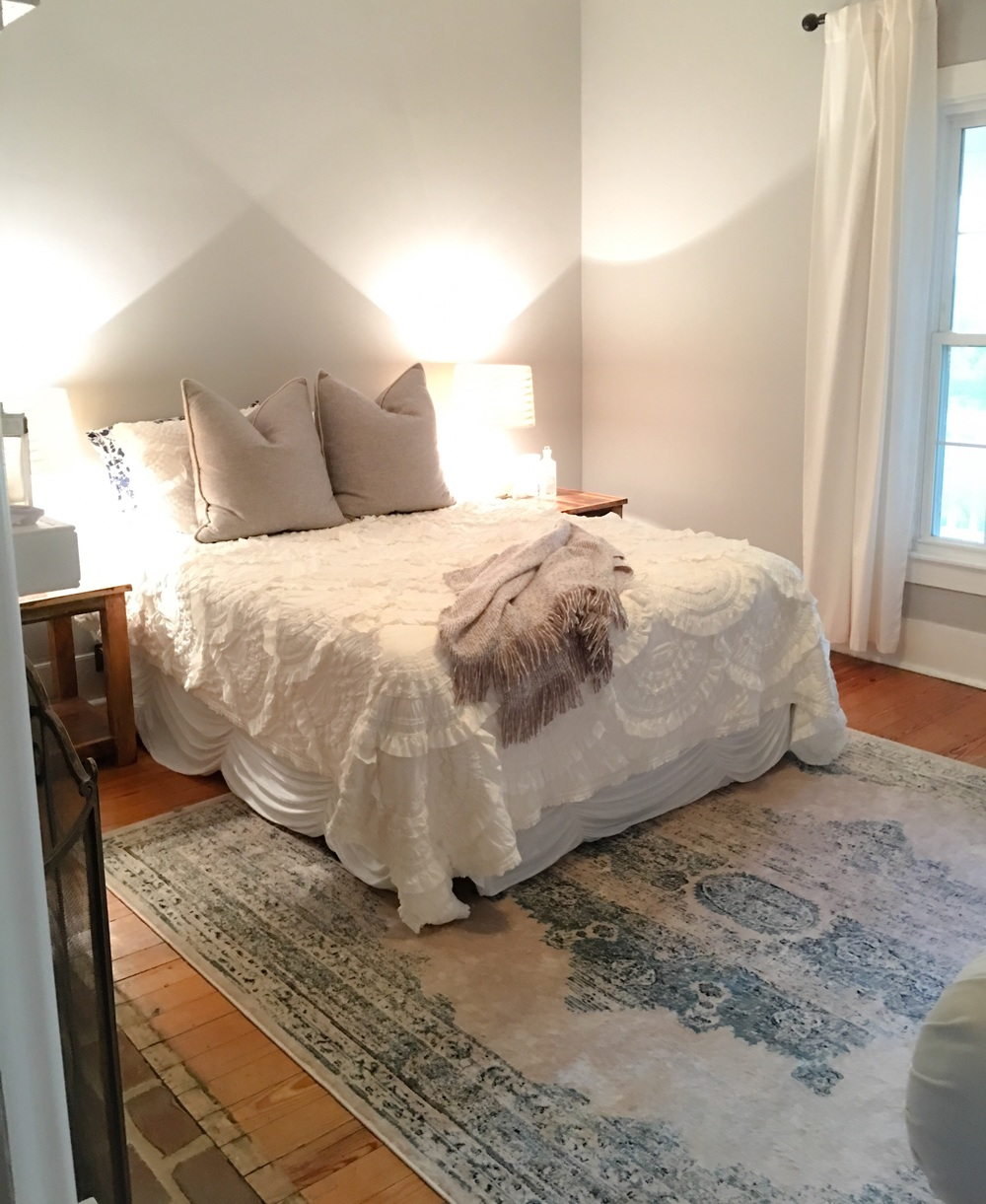 Paint:  Behr, Gentle Rain   Gray Pillows:  Schoolhouse Electric   Bedding & White Pillows:  Anthropologie   Bedskirt:  Anthropologie   Lamps: Target  Throw:  Crate & Barrel   Rug:  Rugs USA    Curtains: West Elm  Nightstands: Reclaimed Barn Wood