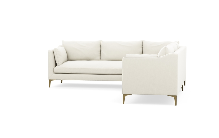 CAITLIN BY THE EVERYGIRL    This sectional gives me all the feels! The gold accents are everything.