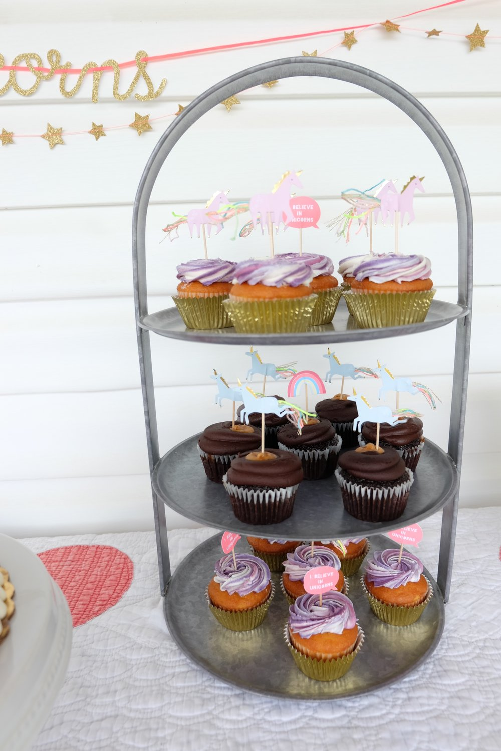 One of my favorite 3 tier trays and it's from Crate & Barrel. It gives such a rustic feel.  The cupcakes were a huge hit! All the decorations are from Land of Nod & Hooray Everyday!! These sweet unicorn cupcake minis are from Land of Nod too!