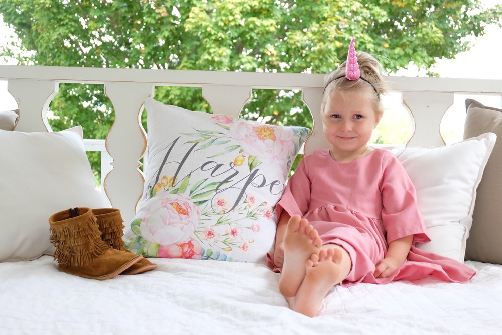 Happy Birthday Harper Grace! Mommy loves you more than you will ever know beautiful girl!!   We had to get a picture of her on the swingbed, even her Harper pillow made an appearance.   I think you should make parties fun and cozy. Think about comfort and most importantly fun. Make all the corners on your front porch comfy and string lights are a must!! :)