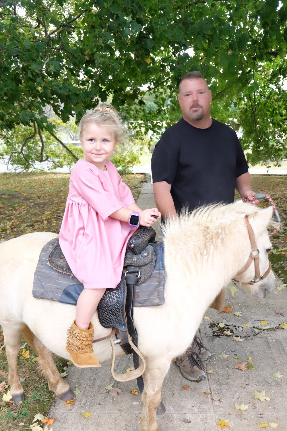 This family came and took everyone on pony rides! The kids loved it so much!! They just walked them all over the yard. I highly recommend trying it out at least once. :) (Harper's dress is from Cedar Road Trading CO and boots are from Gracious May)