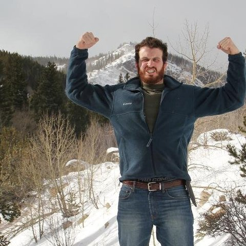 Andy Stiebler and his best Wolverine impression on top of a mountain