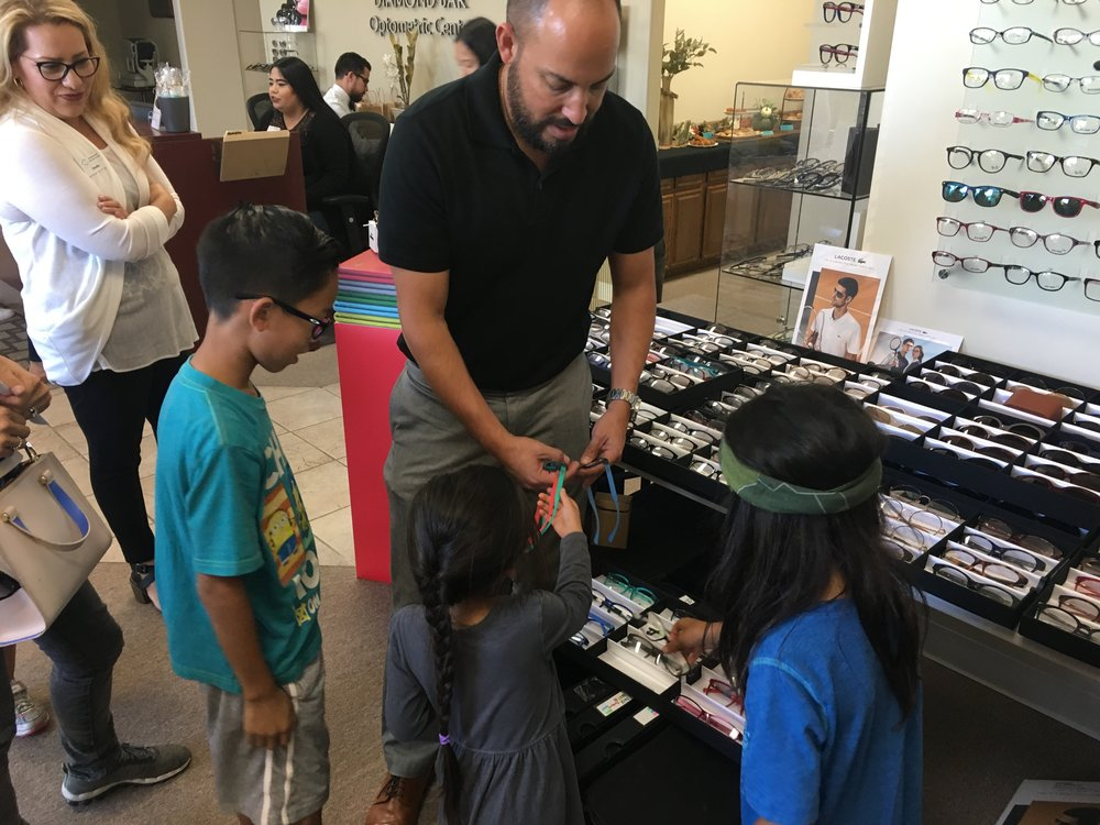Our frame representative from Marchon showing the kids the cool glow-in-the-dark glasses from our featured Lacoste frame line.