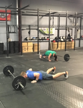 AMRAP x 25 MINUTES TEAMS of 2...  Partner 1 - Max Cal Row or Bike Partner 2 - 5 TTB, 10 Push-up, 15 OHS (75/55)  *Partner 2 is timer, switch with Partner 1 after the OHS, score is total calories