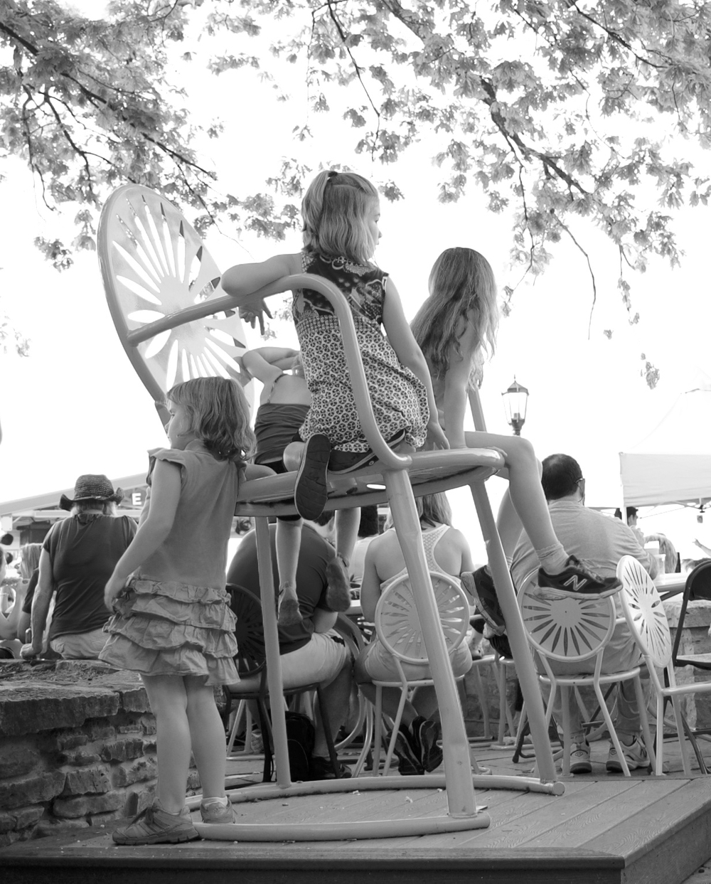 Girls on a Tall Chair. Memorial Union Terrace.Madison, Wisconsin. June 2016. © William D. Walker