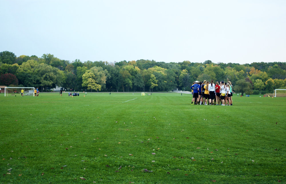 Huddle. University Bay Fields. Madison, Wisconsin. October 2014. © William D. Walker